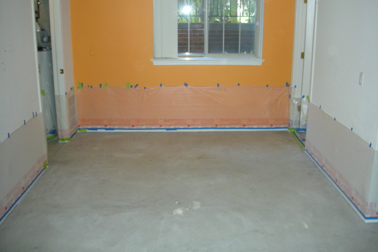 Basement Concrete Floor Cleaned In Preparation For Acid-Staining