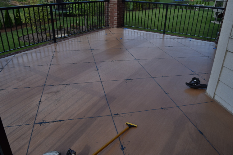 Elevated Backyard Decorative Concrete Terrace During Joint Filling