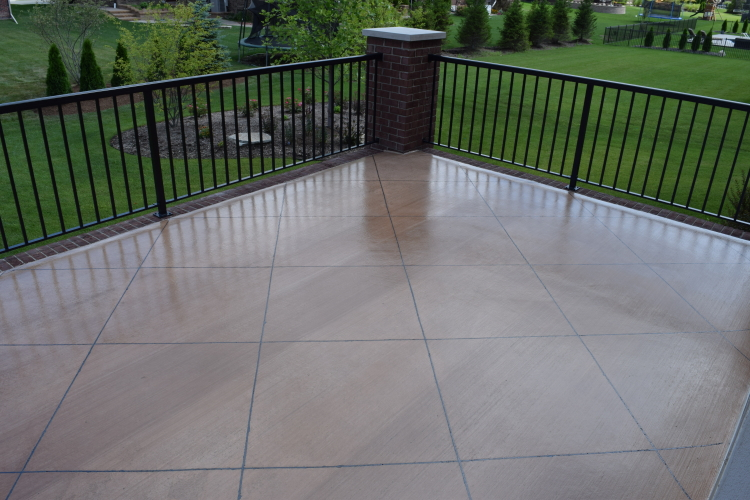 Elevated Backyard Decorative Concrete Terrace After New Sealer And Joint Filler