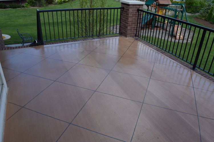 Elevated Backyard Decorative Concrete Terrace With Clear Sealer And Colored Polyurea Joint Filler
