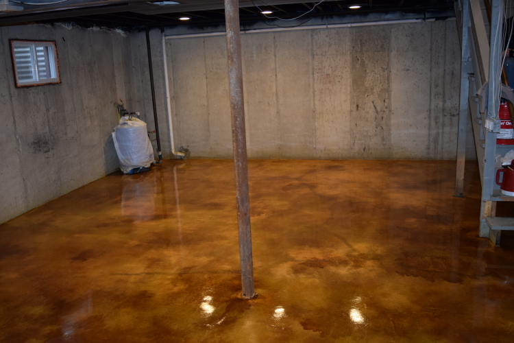Gold Acid-Stained Basement Concrete Floor With Brown Highlights