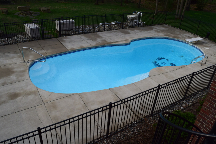 Unfinished Backyard Concrete Pool Deck Before Decorative Spray-Texture Overlay