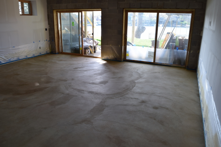 Rough-Troweled, Poorly Finished Basement Concrete Floor After Cleaning