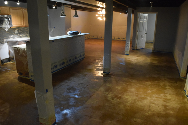 Finished Basement Concrete Floor Damp During Acid-Staining