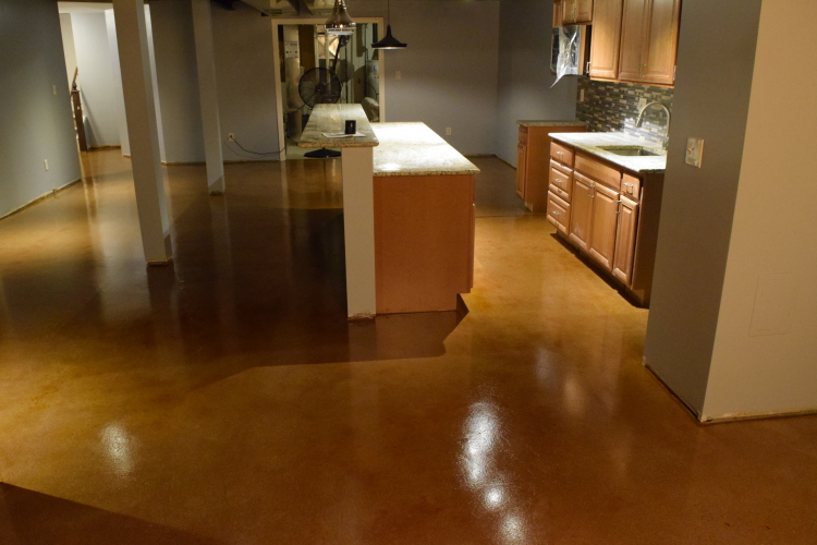 Caramel Acid-Stained Kitchen Concrete Floor In Finished Basement With Clear Epoxy Sealer