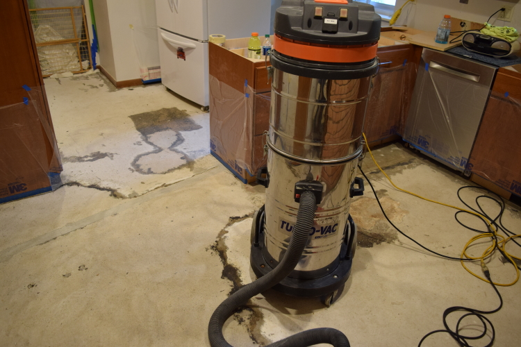 Kitchen Concrete Floor During Tile Adhesive Removal Before Decorative Cement Overlay