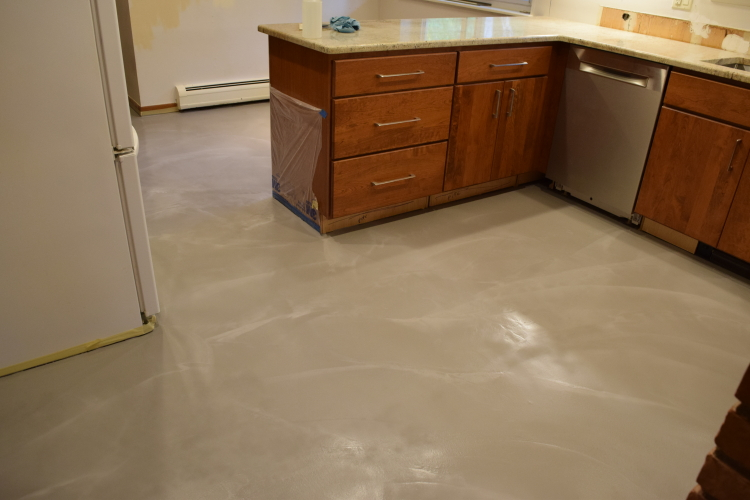 Kitchen Concrete Floor After Resurfacing With Gray Cement Overlay