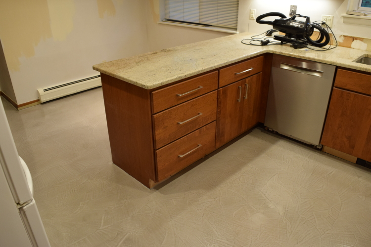 Kitchen Concrete Floor Resurfaced With Gray Cement Overlay Micro-Topping