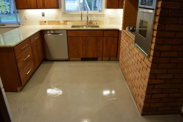 Kitchen Concrete Floor With Gray Decorative Cement Overlay And Clear Epoxy Sealer