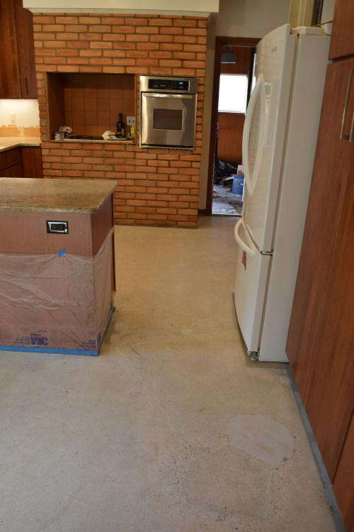 Kitchen Concrete Floor After Grinding Tile Adhesive, Patching And Crack Repair Before Installing Gray Decorative Cement Overlay
