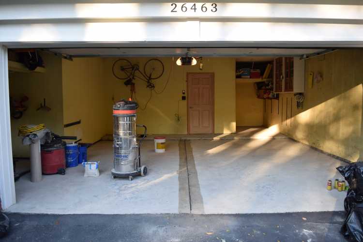 Two-Car Garage Concrete Floor After Grinding And Repairs Before Joint Filling and Applying Colored Polyurea Coating
