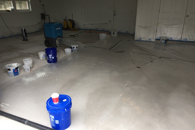 Damp Concrete Garage Floor Being Dried With Dehumidifier Before Acid-Staining