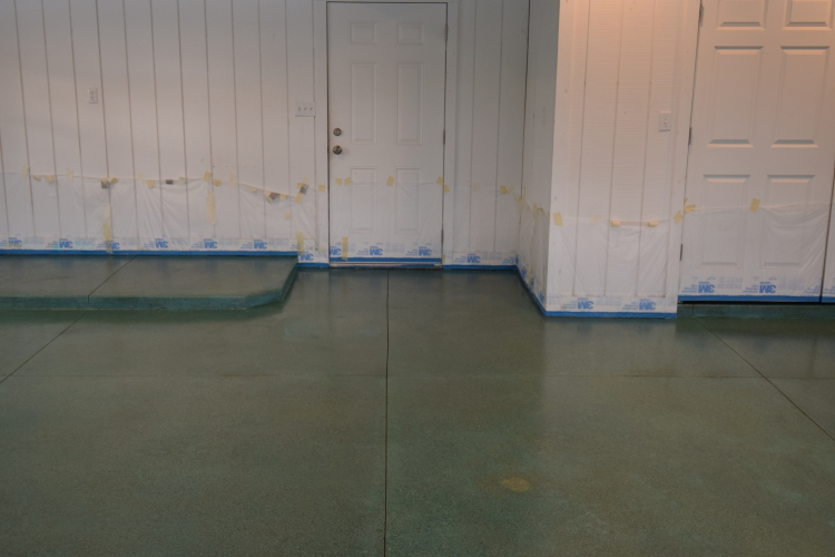 Blue-Green Acid-Stained Garage Concrete Floor With Oil Stain Blemish