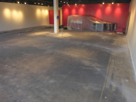 Retail Store Concrete Floor with Black Cutback Adhesive Prior to New Decorative Concrete Flooring