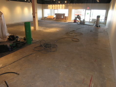 Retail Store Concrete Floor with Tile and Carpet Adhesive Prior to New Decorative Concrete Flooring