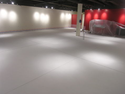 Retail Store Concrete Floor Resurfaced With New White Cement Overlay