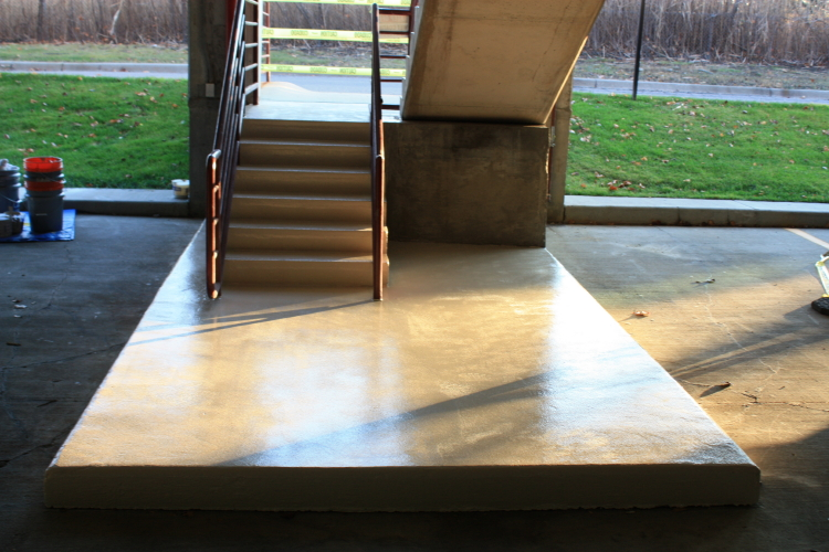 Ground Floor of Parking Deck Concrete Interior Stairwell After Application of New Non-Slip Coating