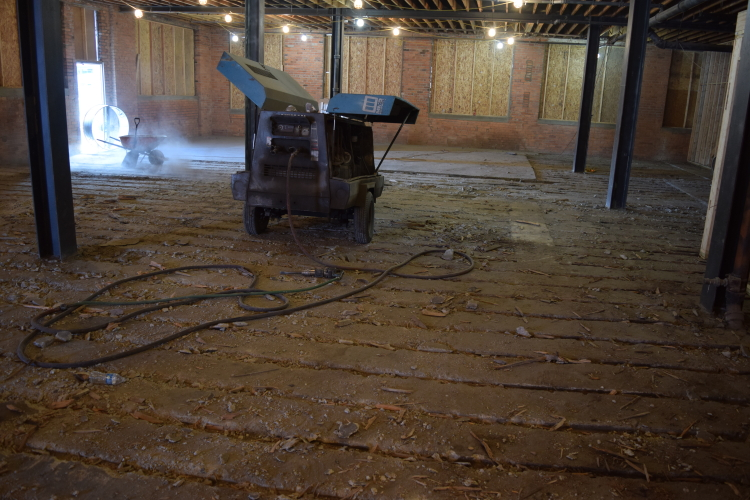 Old Factory Floor In Detroit Being Torn Out Before Installation of Ardex SDT Cement Overlay