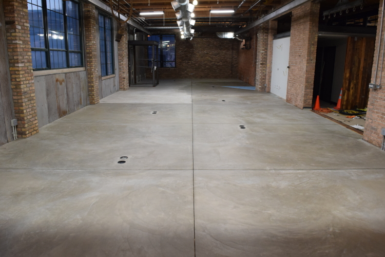 New Concrete Floor In Old Factory After Cleaning And Before Acid-Staining