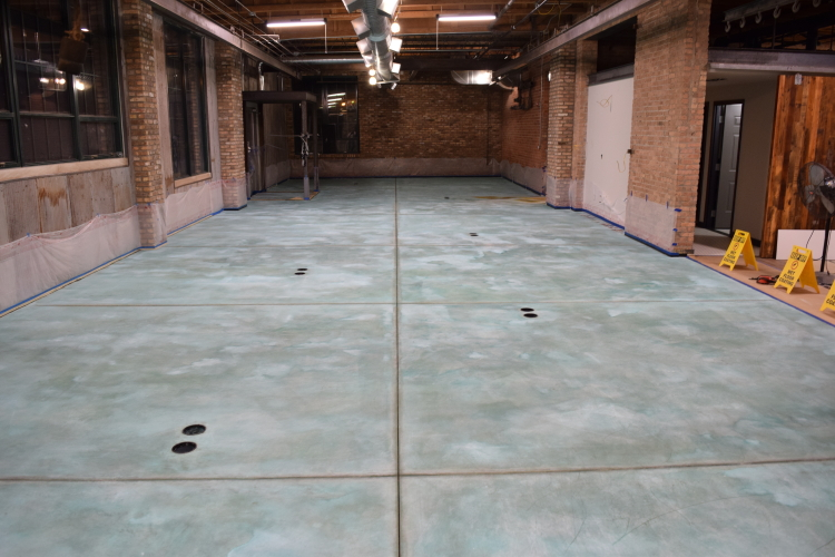 New Concrete Floor In Old Factory After Rinsing Blue Acid Stain Residue