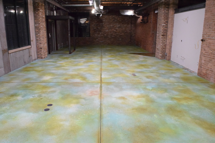 New Concrete Floor In Old Factory After Adding Brown Acid Stain Highlighting to Blue Acid Stain Base Coat