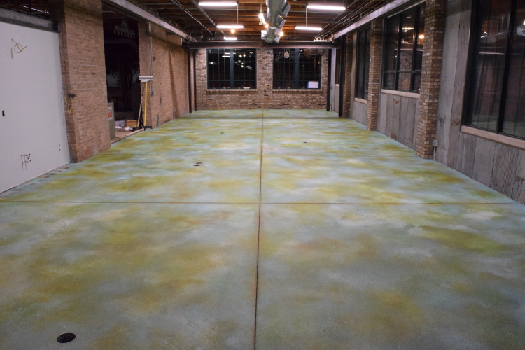 New Concrete Floor In Old Factory After Adding Brown Acid Stain Accenting to Blue Acid Stain Base Coat