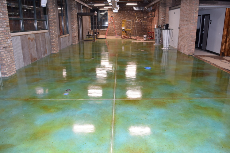 Blue Acid-Stained Concrete Floor With Brown Accenting Sealed with Clear Polyurea