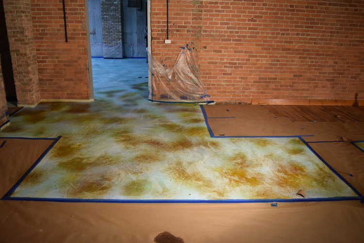 Application of Acid Stain to Integrally-Colored Blue Cement Overlay Of Damaged Concrete Slab Foundation