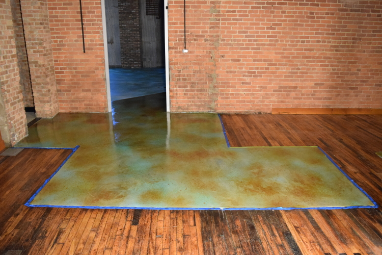 Acid-Stained Blue Cement Overlay of Damaged Concrete Slab Foundation During Application of Clear Epoxy Sealer