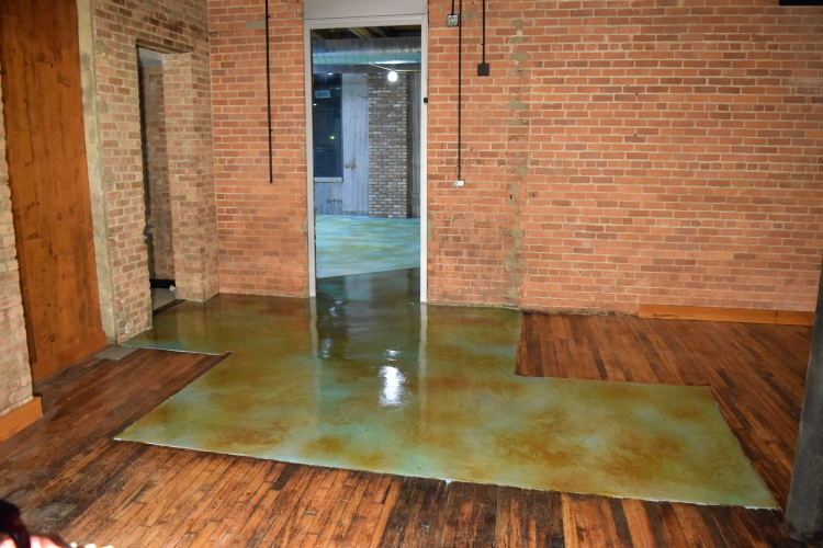 Acid-Stained Blue Cement Overlay of Damaged Concrete Slab Foundation After Application of Clear Epoxy Sealer