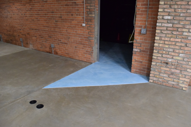 Concrete Floor Museum Entryway With Blue Cement Overlay To Match New Interior Decorative Concrete Flooring