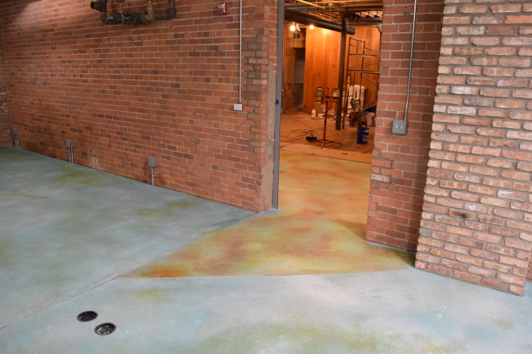 Concrete Floor Museum Entryway After Acid-Staining Blue Cement Overlay To Match Interior Decorative Concrete Flooring
