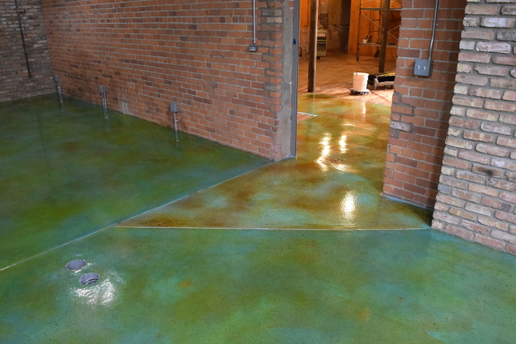 Acid-Stained Blue Cement Overlay Of Museum Entryway Concrete Floor After Applying Clear Epoxy Sealer