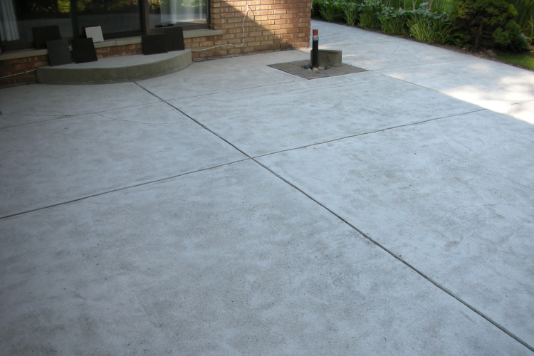 Backyard Concrete Patio After Shot Blasting And Grinding Before Installing  Decorative Concrete Overlay   Moulliet