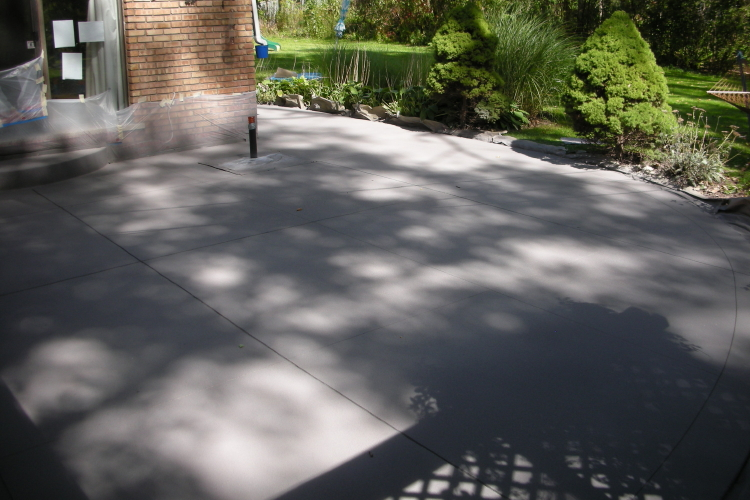 Decorative, Spray Texture, Charcoal Gray Overlay of Backyard Concrete Patio Resurfaced Before Clear Sealer