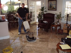 "Maintenance programs for marble floors usually include a ""buffable"" floor polish and a high-speed ""burnisher"" to preserve a high degree of gloss.  The same can be done on acid-stained concrete."
