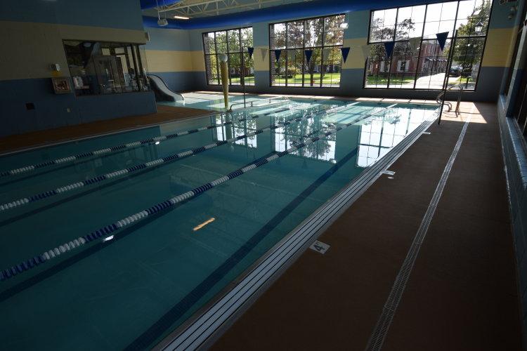 Indoor Concrete Pool Deck With Decorative, Spray-Texture Cement Overlay