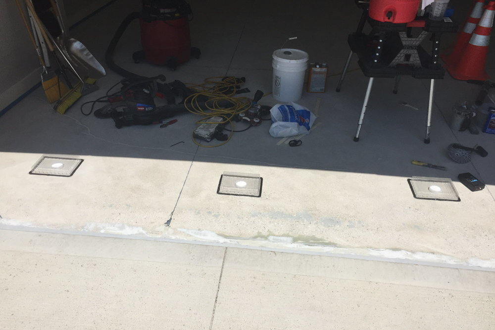 Excess moisture in this new garage floor due to improper rainwater drainage caused crumbling, pitting and cracking after only 2 years.  We are performing moisture vapor transmission testing to determine the extent of the problem.
