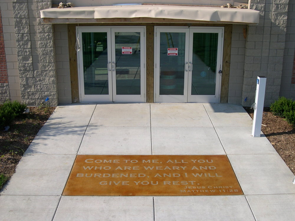 Acid-Stained Concrete Church Entryway With Engrave Bible Verse And Clear Sealer