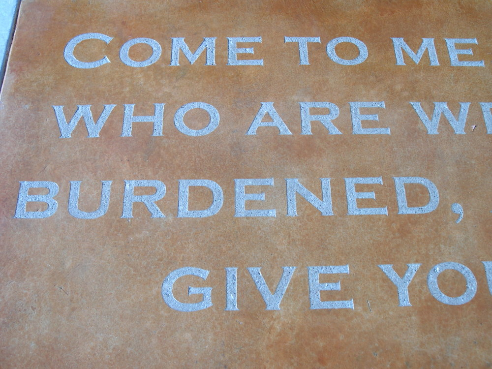 Closeup View of Acid-Stained Concrete with Engraved Bible Verse