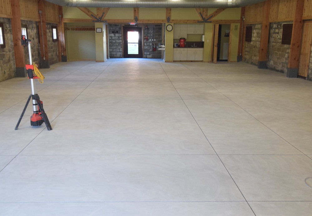 "This concrete floor was hand ground with a 7"" diamond cup grinder to remove a thin sealer in preparation for a new coating.  Notice the uniform, off-white appearance.  This is how concrete should look prior to acid-staining."