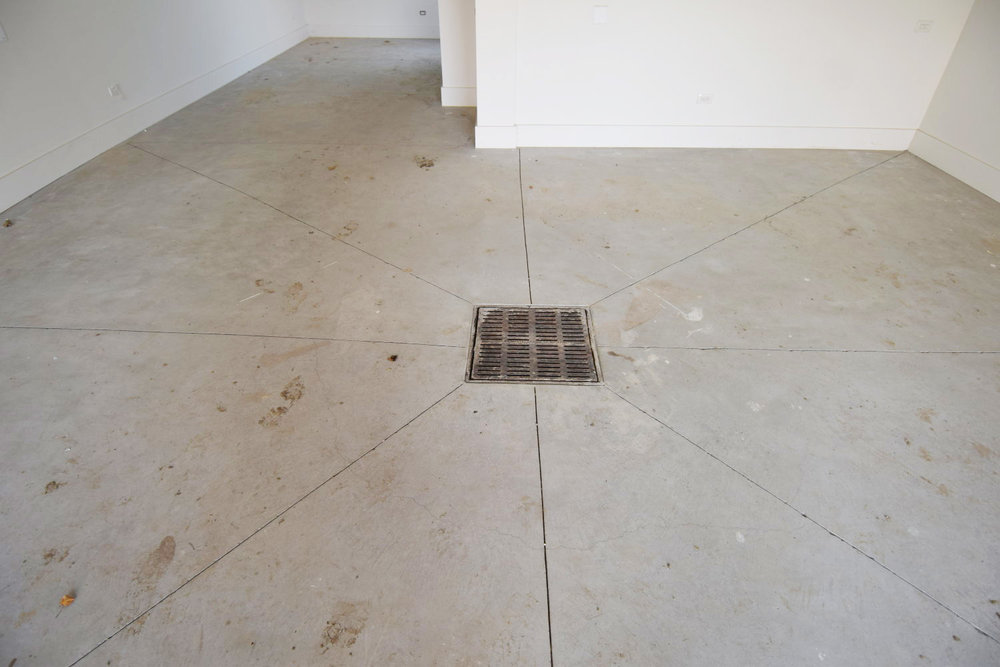 On this two-car garage acid-stained concrete flooring project, we also recommended filling the saw-cut joints to prevent spalling from vehicle tires and to ease winter maintenance.
