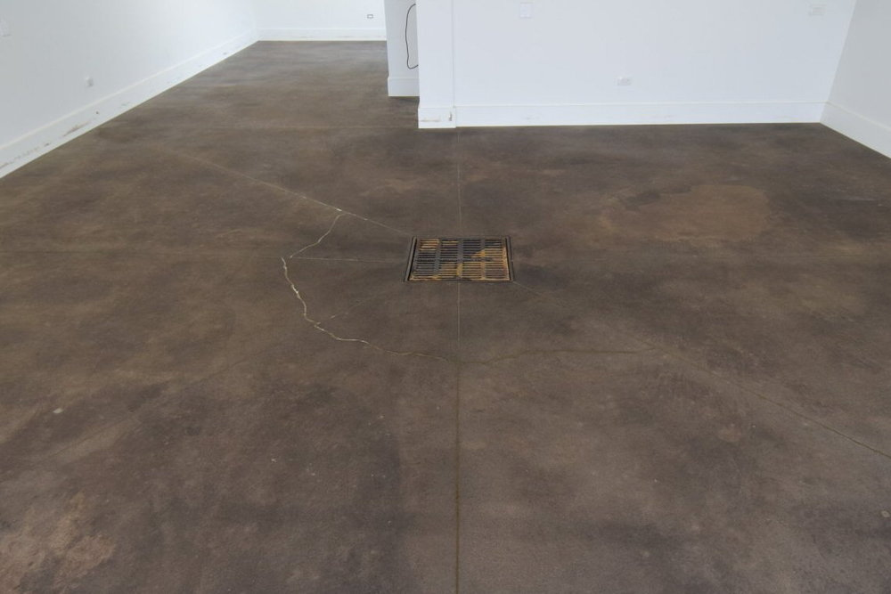 Because there were so many joints, we filled them with a polyurea joint filler of a similar, rather than accent, color so that they wouldn't be seen once the floor was stained and sealed.