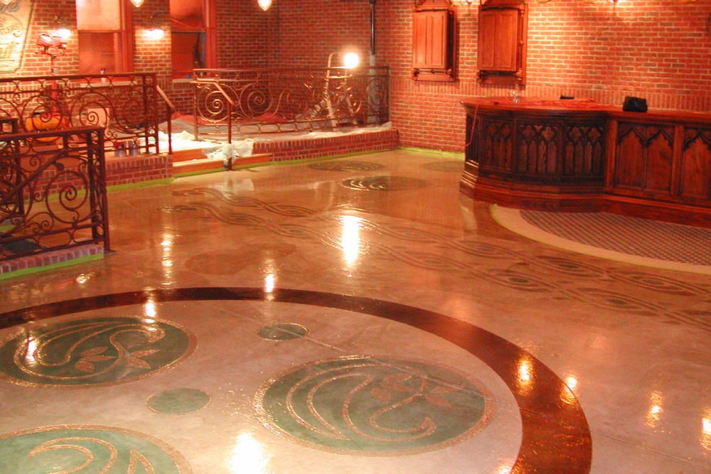 Award-winning concrete engraving with acid-staining and clear epoxy sealer in Irish pub restaurant in Farmington Hills, Michigan. Installed by Premier Veneers in 2004.