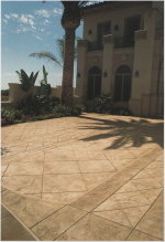 This is a driveway that was saw-cut with a pattern, and then acid-stained, so as to create a South-western motif that would complement the architectural style of the residence.