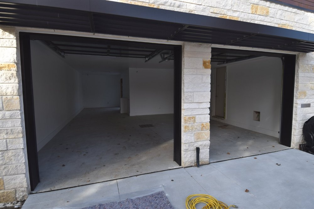 Custom Home Garage Concrete Floor Before Cleaning In Preparation For Acid-Staining