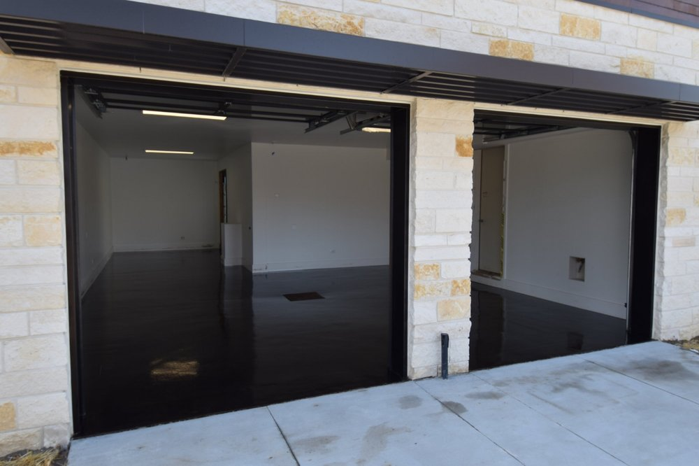 Custom Home Garage Concrete Floor Acid-Stained Black With Clear Polyurea Sealer
