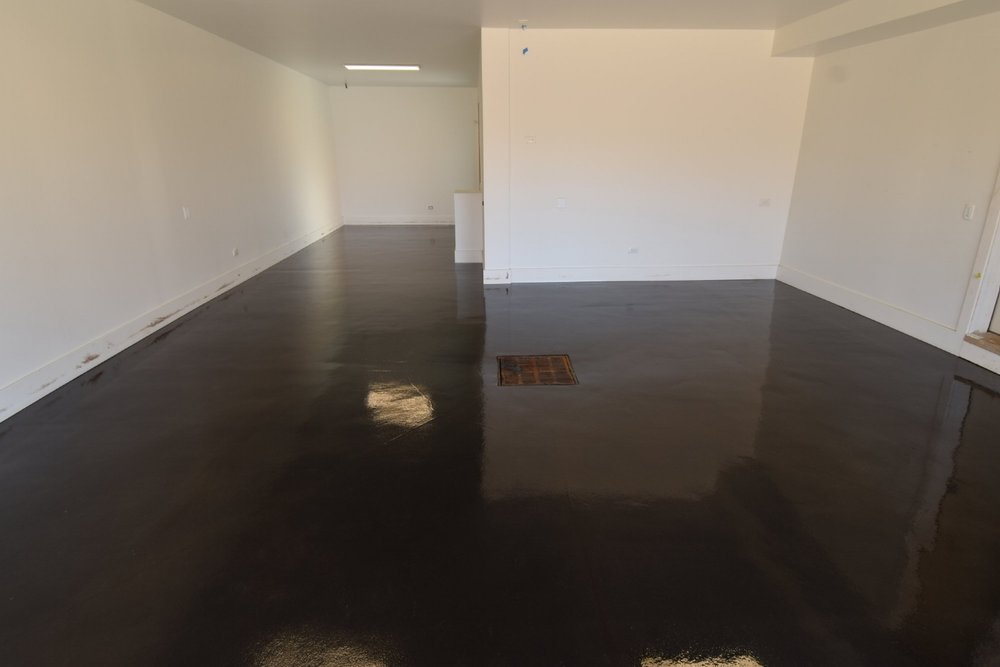 Black Acid-Stained Garage Concrete Floor With Clear Gloss Polyurea Sealer And Matching Joint Filler