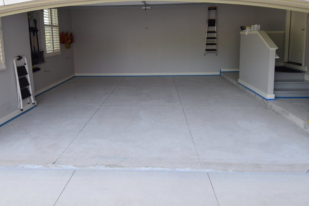 Garage Concrete Floor After Grinding And Repairs In Preparation For Installation Of Polyurea Color Flake Coating System