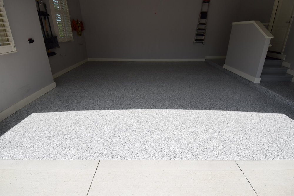 Garage Concrete Floor With Newly Installed Polyurea Color Flake Coating System
